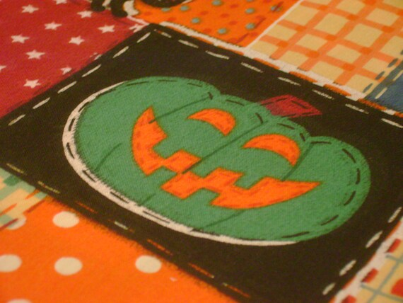 Colorful Halloween Fabric With Jack O Lanterns And Black Cats In A  Patchwork Design