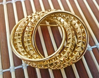 Gold textured infinity ring brooch