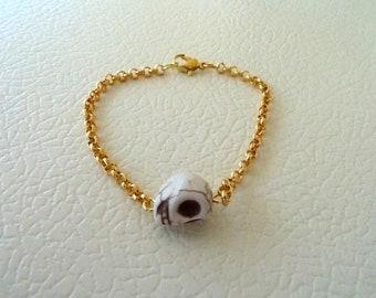 Sideways cream skull bracelet