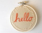 Embroidery Hoop Wall Art - Hello with coral stitch in tangerine and peach