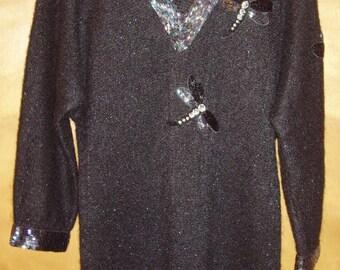 Black wool knit dress by Oleg Cassini.