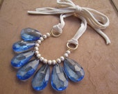 Statement Bib Necklace with Blue Teardrops, Golden Cream Crackle Beads, and Cream Tie