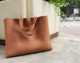 Leather shopping bag with raw stitches