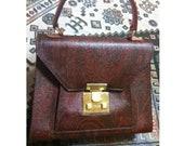 Vintage Etro kelly style handbag with iconic paisley pattern.