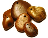 caramel stones: six natural drilled beach rocks