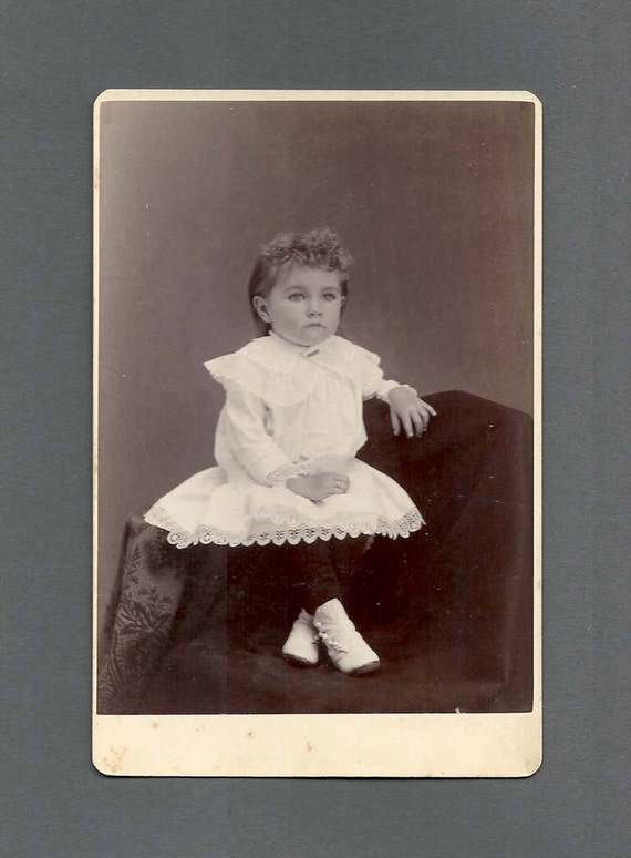 Cabinet Card of a Doll-Like Child in White
