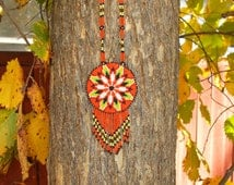 native  american beadwork,pow-wows, morning star design,eagle feather necklace