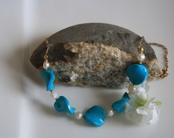Turquoise Blue Twist beads necklace, with fresh water pearls on a gold plated chain.