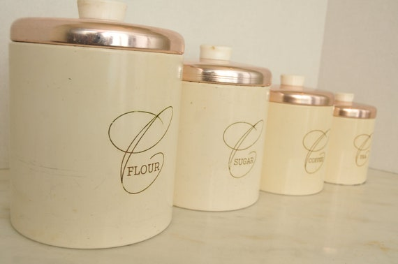 Vintage cream and pink kitchen canister set 4 bakelite handles for Kitchen set pink