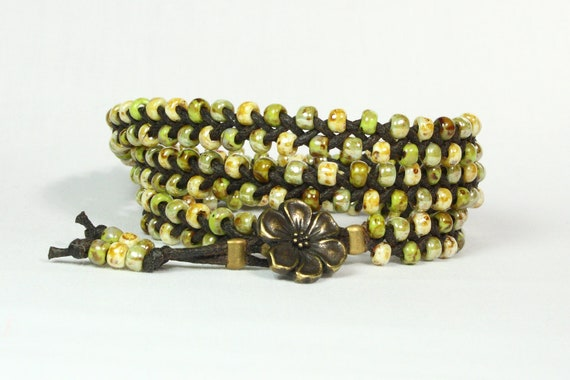 Triple wrap bracelet.  Green, brown, cream TOHO seed beads. Chocolate dark brown cord.  Antique brass flower button.  Hippie.