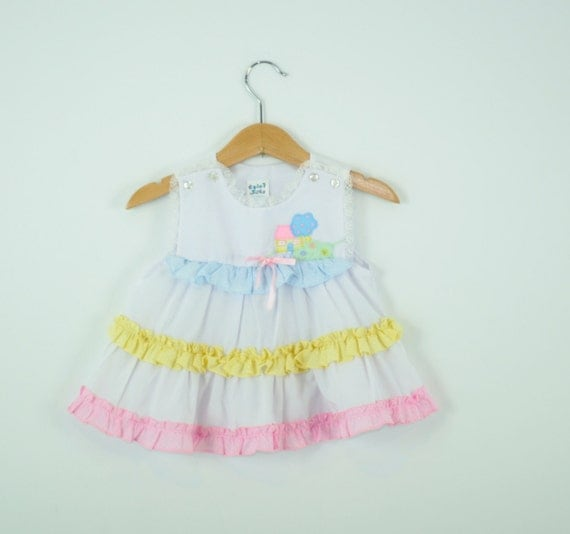 Vintage Baby Dress in Pastel Pink Blue and Yellow With Lace