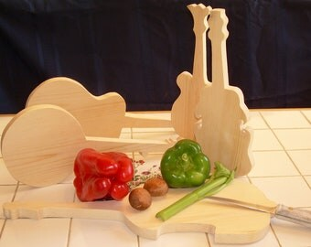 Cutting boards shaped like musical instruments