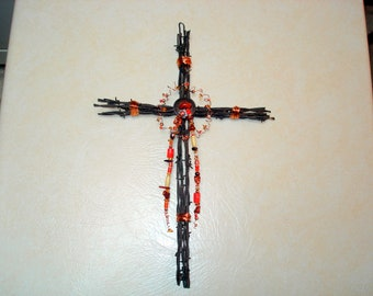Cross made from barbwire and beadwork