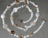 Natural off-white sea shell and freshwater pearl necklace.