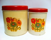 Vintage red floral canisters.  Set of 2.  Tin metal