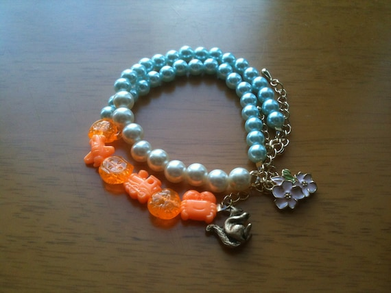 2 critter cute bracelets orange, blue and white pearls, sakura and squirrel pendant with gold adjustable clasp