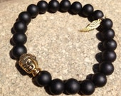 Black onyx with gold Buddha accent charm bracelet