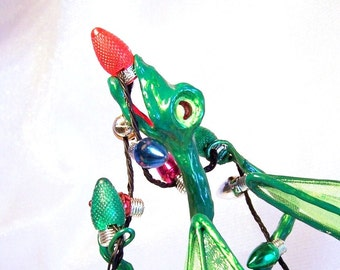 Green Dragon Tangled in Christmas Tree Lights