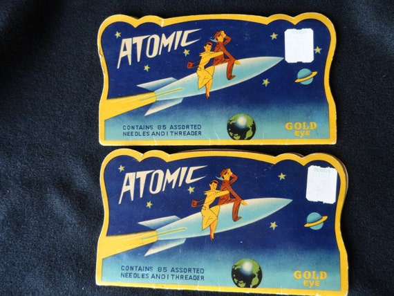 Atomic Needles Cosmic Space Rocket Planets Stars Couple Vintage Advertising