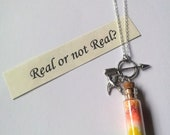 Catching Fire Hunger Game inspired necklace with scroll message