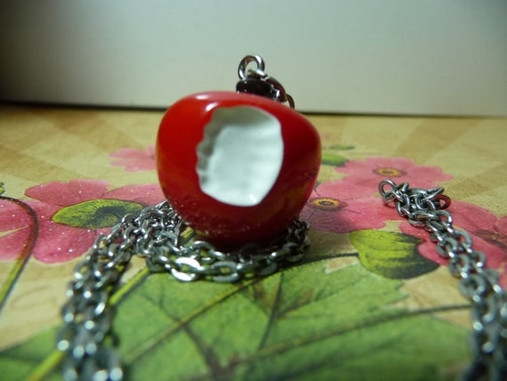 Snow White's Bitten Apple necklace by vintagerust
