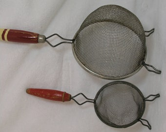 Vintage Kitchen gadgets c. 1950s, Potato Masher (wood handle) and Strainers ( red handles)