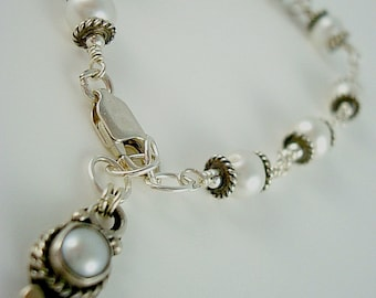 Pearl and sterling silver charm bracelet. White bridal jewelry. Wedding or casual.