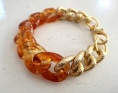 Amber plastic and metal chain bracelet