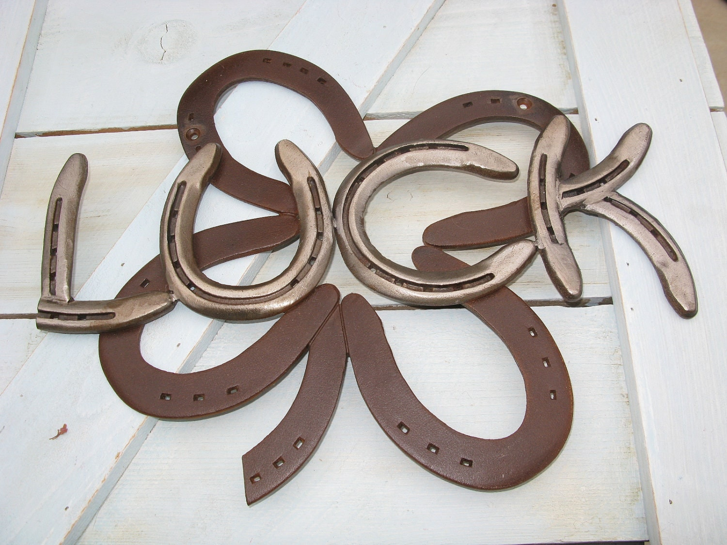 Four leaf clover luck recycled horseshoe sign rusted by for Things you can make with horseshoes