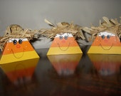 Candy corn shelf sitter with straw hat and raffia hair