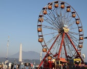 Art photography of Ferris Wheel in Lucerne Switzerland with Alps in the background