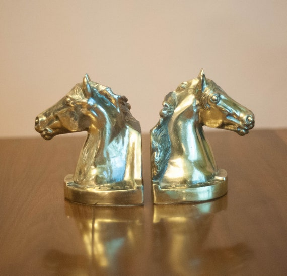 Vintage pair of gold horse head bookends Hollywood Regency