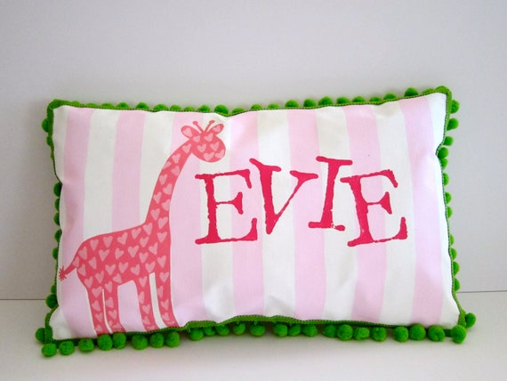 Baby pillow in light pink stripes with bright pink giraffe. Personalized with name.