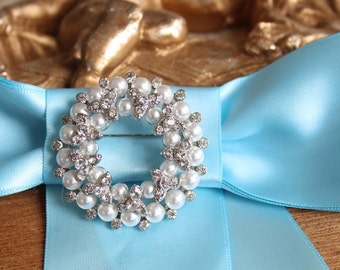 Beautiful silver color brooch with sparkling rhinestones and  pearls