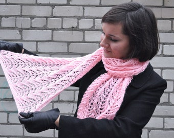 Knitted light pink woman scarf.