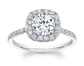 Ladies 18kt white gold diamond halo engagement ring with 1ct Round white Sapphire and 0.40 ctw G-VS2 quality diamonds