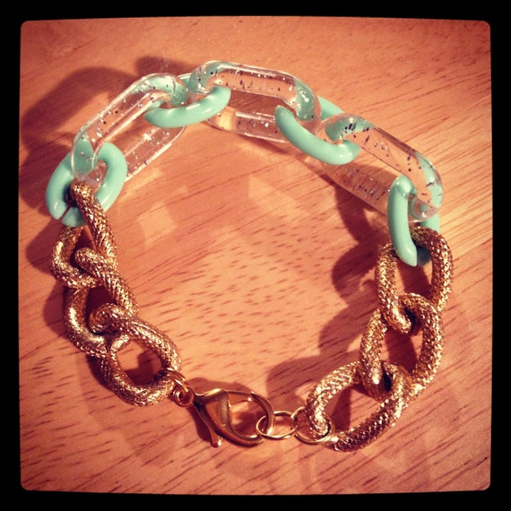 The KATE Bracelet Is A Textured Gold Chain Linked With A Hint of Mint Green Resin & Clear Glitter Resin Chains