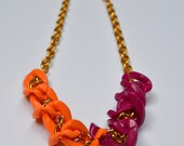 Golden Twist Statement Necklace in Orange/Magenta: Acrylic and Gold Chain Link