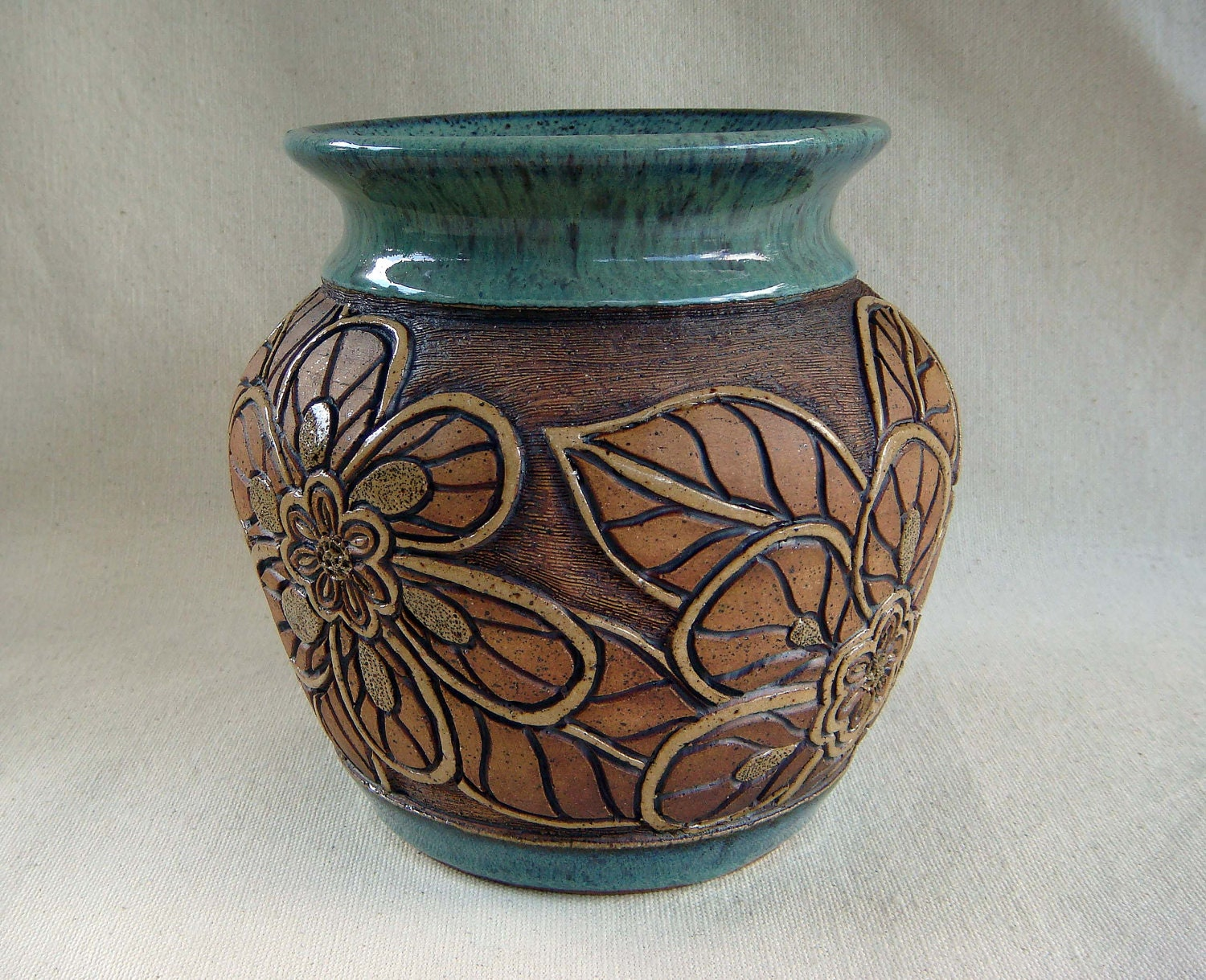 Pottery hand carved vase with flower design by