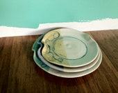 Blue and tan stacking pottery plate set