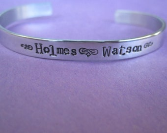 "Hand Stamped  ""Holmes  Watson"" Bracelet"