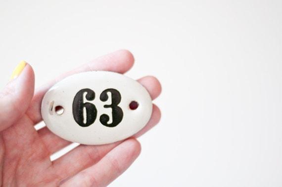 Vintage enamel number sign 63