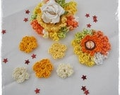 Collection of floral embellishments in orange yellow white and pale green
