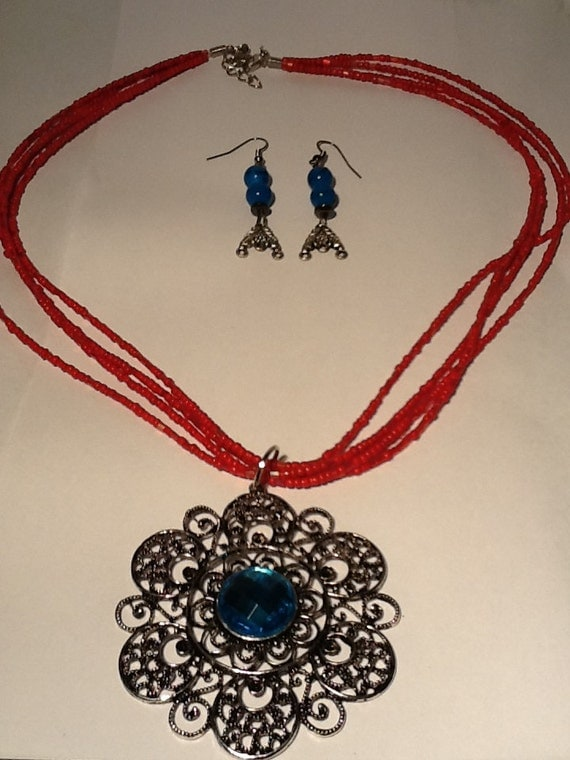 Unique Handmade beaded necklace with silver and blue centered crystal medallion