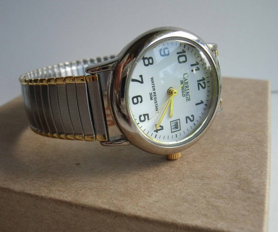 """Vintage Timex """"Carriage"""" watch with silvertone and goldtone band. Water Resistant."""