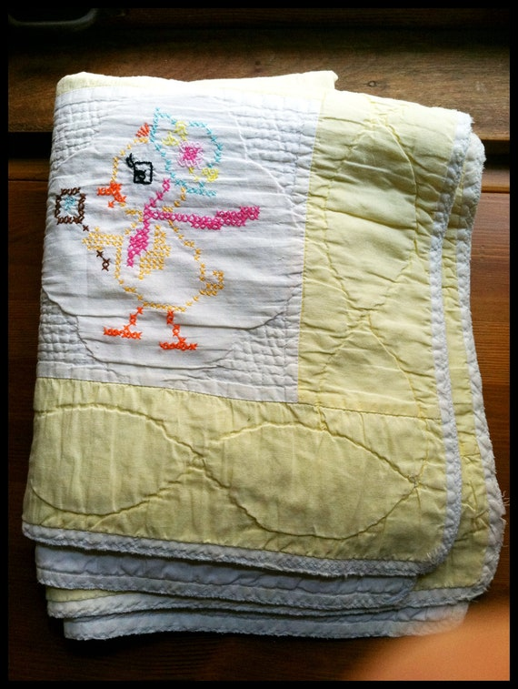 vintage handmade yellow embroidered child's quilt