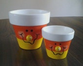 Two Candy Corn Painted Clay Pots