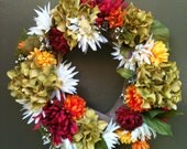 Beautiful, silk flower, fall wreath. Made with foam wreath, wrapped in burlap and touches of color.