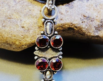 Faceted Garnets Encased in Silver on a 5 Strand Vegan Cord