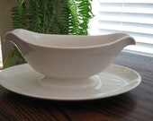 Charming White Pottery Gravy Boat with Double Spouts and Attached Serving Plate